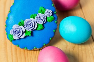 Easter homemade gingerbread cookie and eggs on wooden table