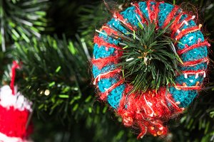 Knitted toy on Christmas tree