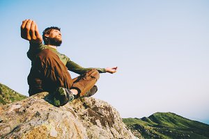 Man traveler meditating yoga
