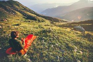 Man in sleeping bag enjoy mountains