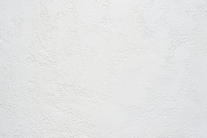 white travertine plaster textured background, copy space