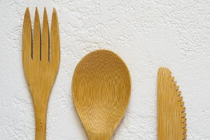 Bamboo fork, knife and spoon on white background closeup, Top vi