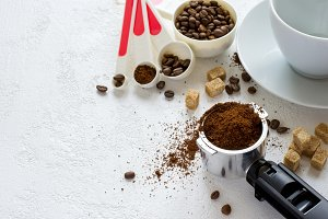 Ingredients for coffee: ground coffee in the horn of the coffee