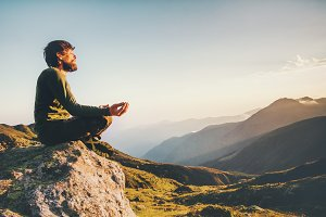 Man meditating yoga at mountains