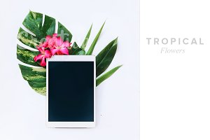 Tablet with tropical flowers