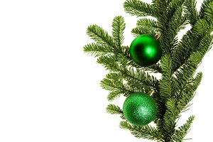 Noble fir bough with green ornaments
