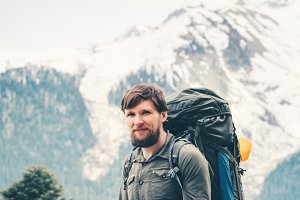 Traveler Man hiking with backpack