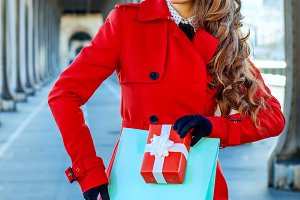 woman In Paris with shopping bag and Christmas present box