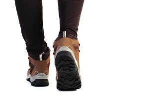 Man feet in new trekking shoes