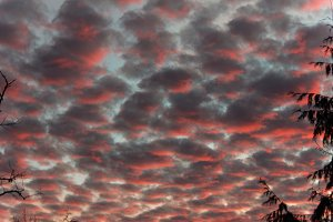Dramatic sunset cloud formation with red color