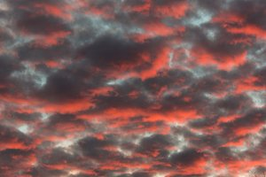 Red sunset cloud formation vertical