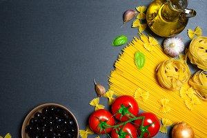 Top view: pasta or italian spaghetti on black stone slate background