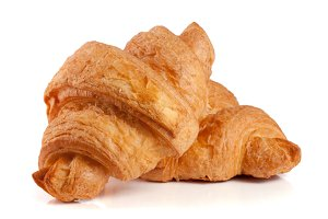 two croissant isolated over a white background closeup