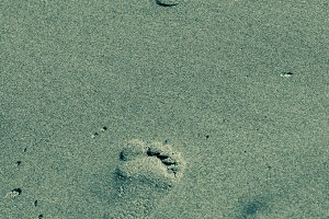 Footsteps on the beach sand
