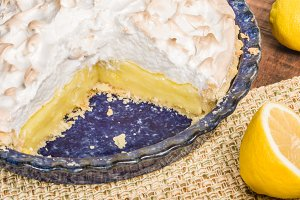 Lemon meringue pie with slices missing