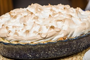 Baked lemon meringue pie with blue pie pan