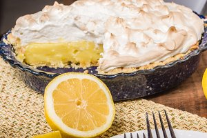 Homemade lemon meringue pie with lemons