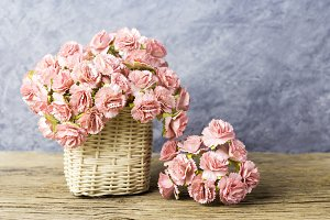 Paper carnation in basket