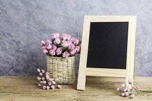 Paper pink rose flowers and board