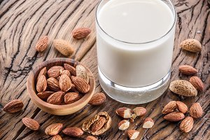 Almond nuts and milk on wood