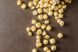 Sweet popcorn in a bowl. Gray background. Watch a movie.