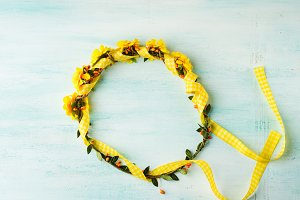 Yellow flower wreath girl head band on pastel background