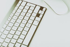Keyboard and mouse on white background. Technology.