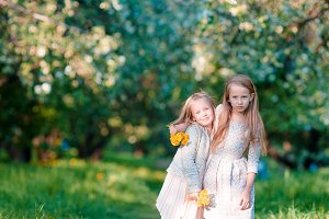 Adorable little girls on spring day outdoors
