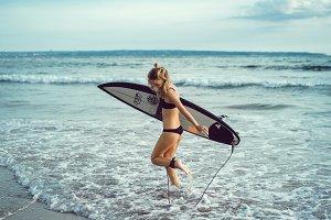 Girl surfboard in ocean