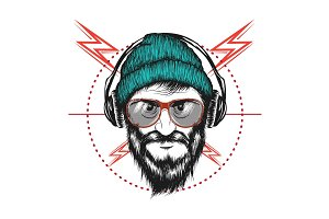 bearded man listening a music in headphones
