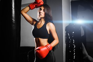 sexy fighter girl in gym boxing