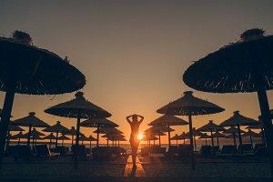 girl look at sunset on beach