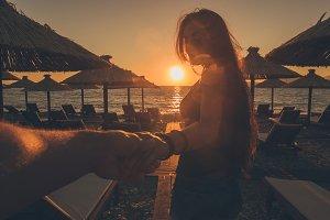 man follow woman at sunset