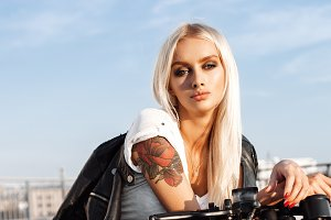 Biker woman in leather jacket on motorcycle