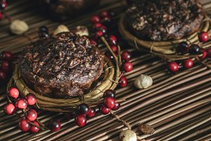 Chocolate Muffins rustic background.