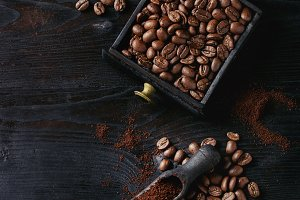Roasted coffee beans over black