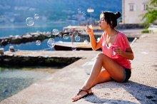 girl blow soap bubbles