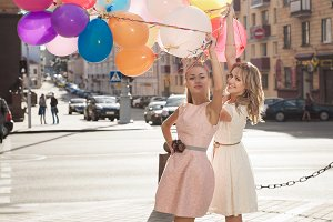 Two women with colorful balloons
