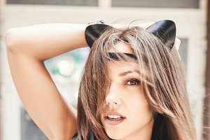 Bully sexy woman with leather cat ears.