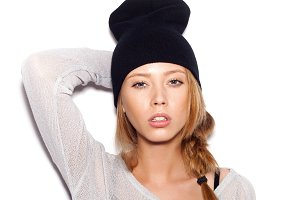 young woman in black beanie