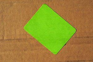 Green tag on cardboard