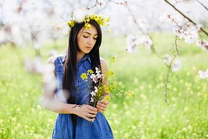 girl with flowers in spring blossom