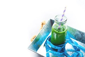 Healthy food diet concept green spinach smoothie meter