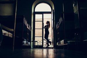 Silhouette of girl in hostel