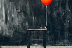 red balloon with chair