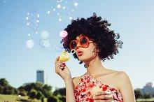 Vintage photo of soap bubble blower woman