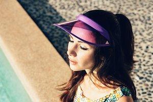 Fashion girl in beautiful bikini lying near swimming pool