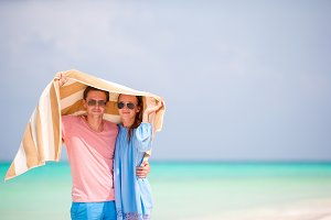 Portrait of happy couple in honeymoon on the beach
