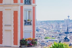 Beautiful european houses and balcony view in Paris, France. View to the city from Montmartre