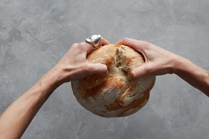 hand breaking Bread